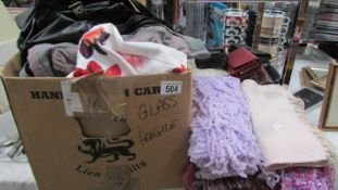 A large lot of hand bags, purses, scarves etc.