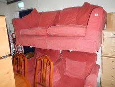 A good quality three piece suite with cushions and removable covers. (Collect only).