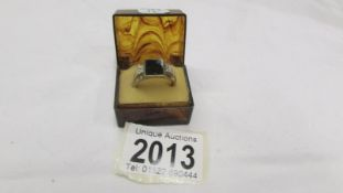 A yellow gold onyx and diamond ring, size Q. 4.6 grams.