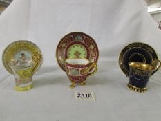 Three hand painted Vienna tea cups and saucers, in good condition.