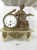 A 19th century mantel clock surmounted figure.