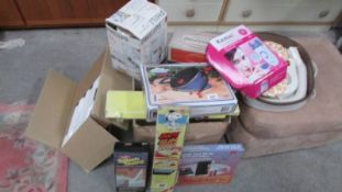A mixed lot of boxed household items.