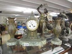 A French marble and spelter clock garniture, in working order.
