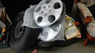 Three wheels with tyres, wheel rims, motoring books etc., (Collect only).