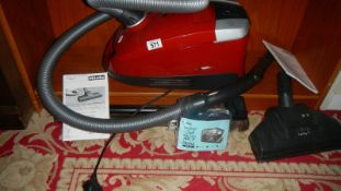 A Miele Compact C2 cat and dog powerline vacuum cleaner with instructions,. in working order.