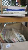 A box of television periodical and four books.