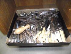 A box of vintage flatware cutlery
