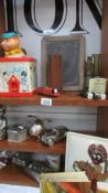 A mixed lot of vintage toys, money boxes etc.