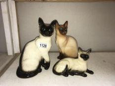 A Royal Doulton Siamese cat,