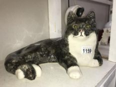 A signed Winstanley cat with glass eyes, size 7,