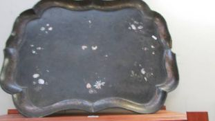A large 19th C oriental lacquered tray inlaid with mother of pearl a/f