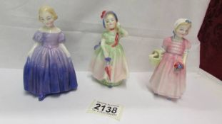 Three Royal Doulton figurines - Marie Hn 1370, Babie HN 1679 and Tinkle Bell HN 1887.