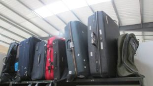 Nine suitcases. (Collect only).