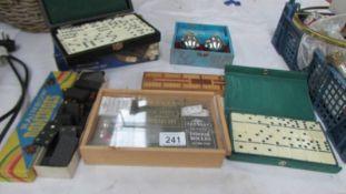 Three sets of dominoes, crib board etc.
