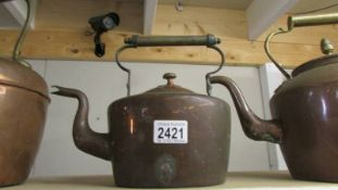 An old copper kettle.