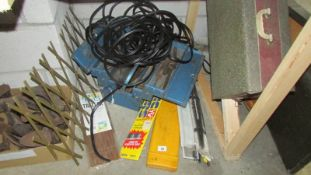 A cantilever tool box with tools, various wiper blades etc.