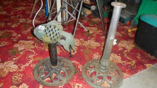 Two cast iron stands and a cast iron fish. (Collect only).