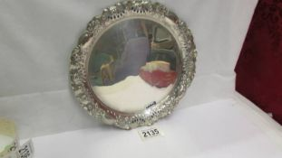 A hall marked silver card tray. In good condition.