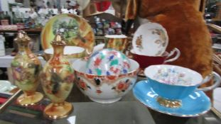 A mixed lot of tea cups and saucers etc.