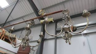Two electric chandeliers and a wall light.