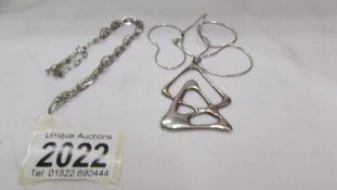 A silver pendant and a silver bracelet (bracelet needs repair).