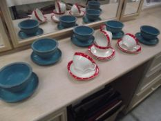 An 8 piece vintage set of polka dot cups and saucers and 5 Poole soup bowls with adjacent saucers