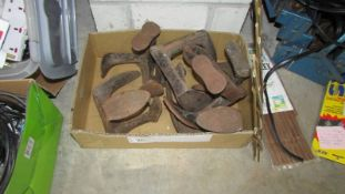 A large box of shoe lasts,