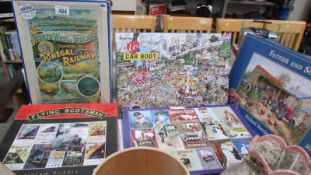 A quantity of jigsaw puzzles.