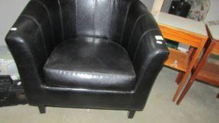A black tub chair.