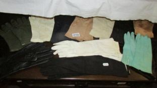 A mixed lot of vintage gloves including leather.