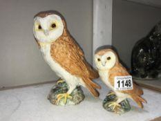 A large Beswick owl & a smaller Beswick owl