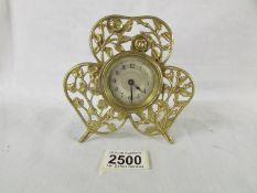 A small brass boudior clock.