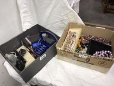 2 boxes of costume jewellery including rings & good quantity of beads & necklaces
