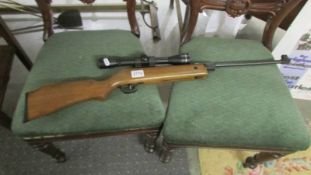 An air rifle with sight. ****Condition report**** Model SMK 15 Cal 4.5mm/.