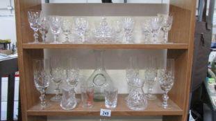 Three shelves of glass ware.