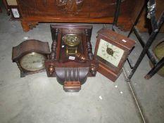 A wall clock and 2 mantel clocks.