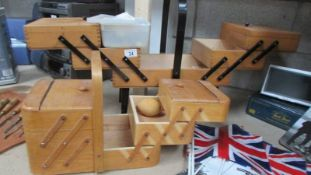Two cantilever wooden sewing boxes,