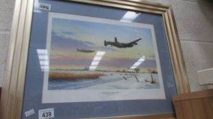 A framed and glazed print entitled 'Lincolnshire Winter 1943'.