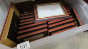 """A large quantity of 6"""" x 4"""" photo frames."""