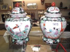 A pair of oriental ginger jars depicting people and birds with floral decoration,