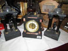 A black marble 3 piece clock garniture, in working order.