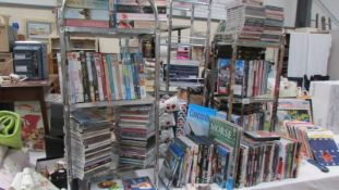 A large lot of DVD's, CD's and books.