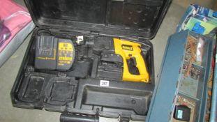 A cased Dewalt drill.