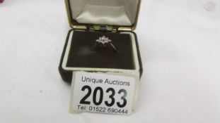 A 9ct gold ring set diamonds, size M, 2.2 grams.