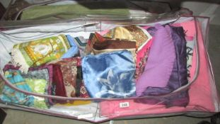 A mixed lot of scarves, blanket etc.