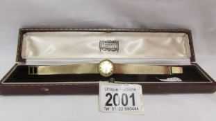 A Jaeger Le Coutre ladies all gold wrist watch, in working order.