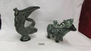 A Chinese Bronzed verdigree effect spelter lidded goat and a similar jug.