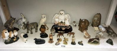 A shelf of animal ornaments including Wade & resin etc.