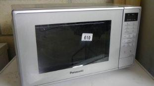 A Panasonic microwave oven, model NN-E28JMM, 1250 watt, no turntable. (Collect only).