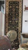 A woven backed carpet runner, 230 x 80 cm.